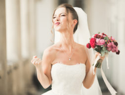 Luxury wedding bride, girl posing and smiling with bouquet.