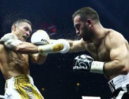 """MOSCOW, RUSSIA - JULY 21, 2018: WBC/WBO champion Oleksandr Usyk (L) of Ukraine, and WBA/IBF champion Murat Gassiev of Russia, in their WBSS (World Boxing Super Series) cruiserweight final bout at Moscow's Olympiyskiy Arena. Valery Sharifulin/TASS  Ðîññèÿ. Ìîñêâà. Óêðàèíñêèé áîêñåð Àëåêñàíäð Óñèê è ðîññèéñêèé áîêñåð Ìóðàò Ãàññèåâ (ñëåâà íàïðàâî) âî âðåìÿ îáúåäèíèòåëüíîãî áîÿ â ôèíàëå Âñåìèðíîé áîêñåðñêîé ñóïåðñåðèè WBSS çà òèòóë ÷åìïèîíà ìèðà ïî âåðñèÿì Âñåìèðíîãî áîêñåðñêîãî ñîâåòà (WBC), Âñåìèðíîé áîêñåðñêîé îðãàíèçàöèè (WBO), Âñåìèðíîé áîêñåðñêîé àññîöèàöèè (WBA) è Ìåæäóíàðîäíîé áîêñåðñêîé ôåäåðàöèè (IBF) â âåñå äî 90,71 êã â ÑÊ """"Îëèìïèéñêèé"""". Âàëåðèé Øàðèôóëèí/ÒÀÑÑ"""