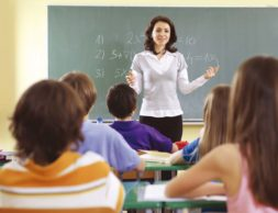 Teacher and student in a classroom at school.