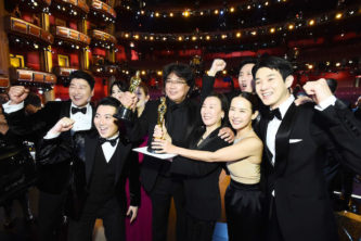 """HOLLYWOOD, CALIFORNIA - FEBRUARY 09: In this handout photo provided by A.M.P.A.S. Best Picture Award winners for """"Parasite"""" pose onstage during the 92nd Annual Academy Awards at the Dolby Theatre on February 09, 2020 in Hollywood, California. (Photo by Matt Petit - Handout/A.M.P.A.S. via Getty Images)"""